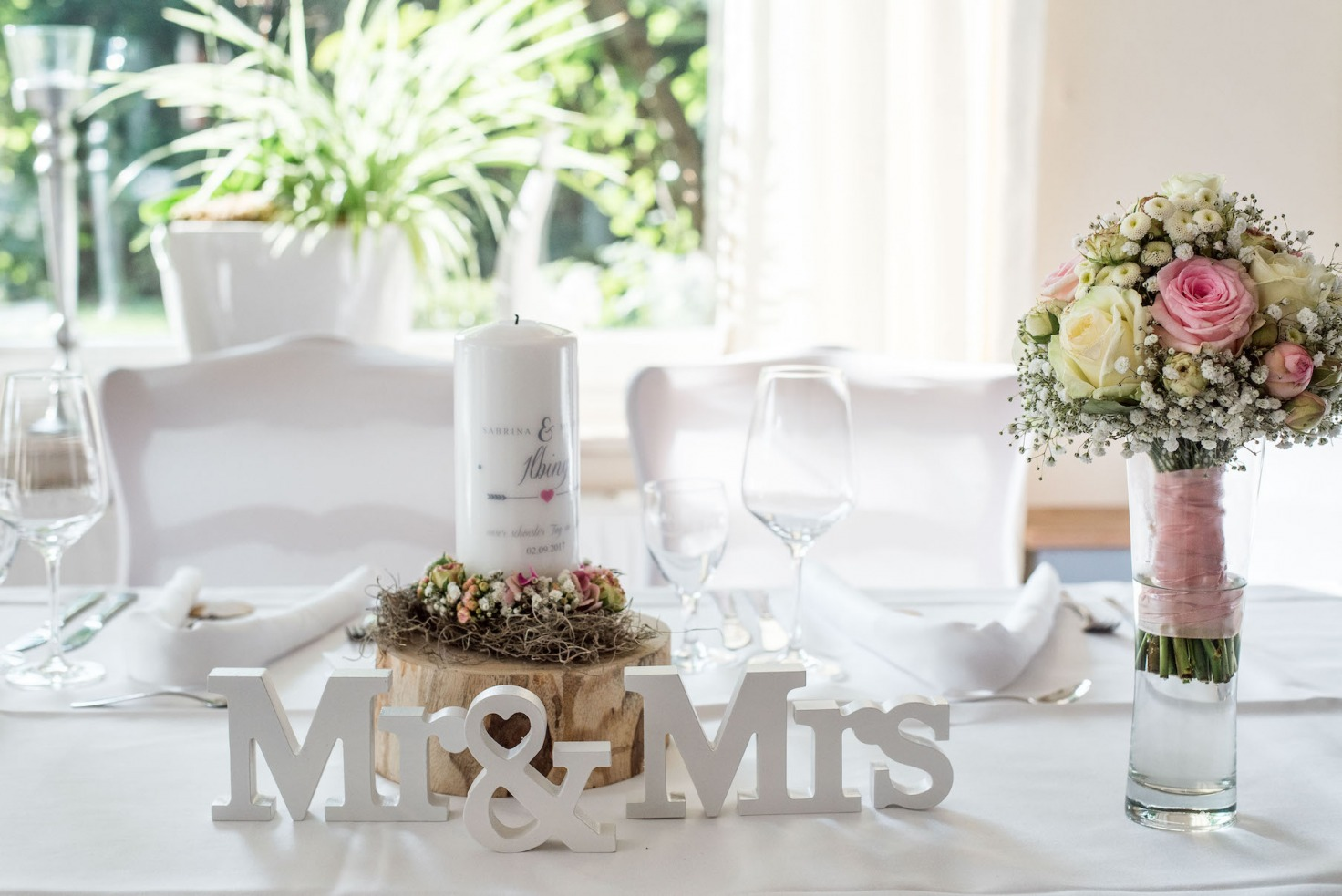 Hochzeit von Sabrina und Michael in Münster: Hochzeitsdekoration auf dem Tisch